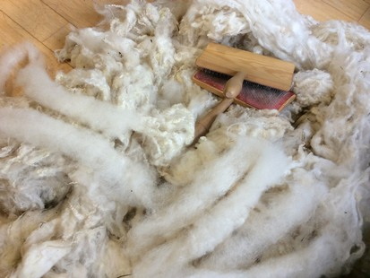 Raw fleece and carders