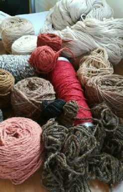 A selection of yarns for a new floor rug
